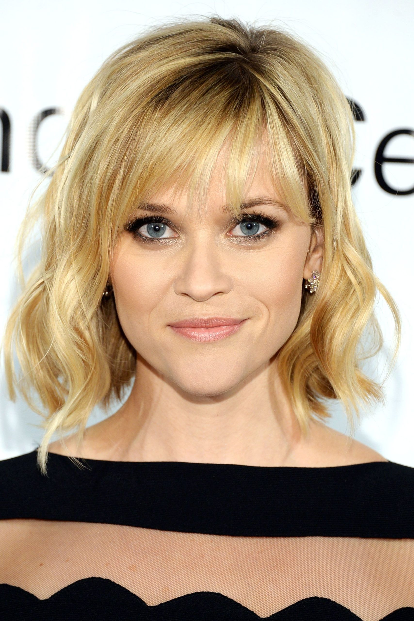 Reese Witherspoon Side parted layered bob